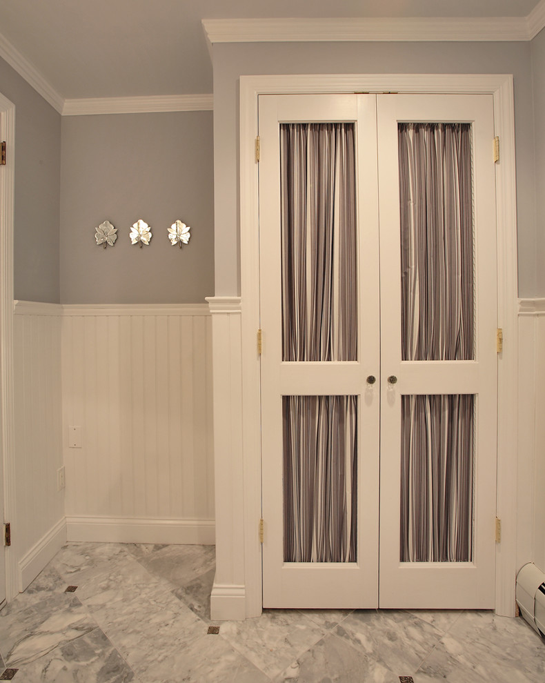 Example of a classic powder room design in Other