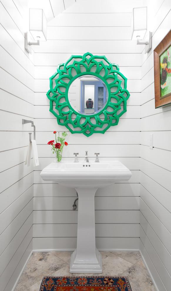 Powder room - small coastal travertine floor powder room idea in Austin with a pedestal sink and white walls