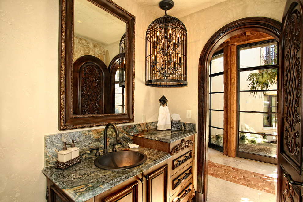 Inspiration for a mediterranean powder room remodel in Austin