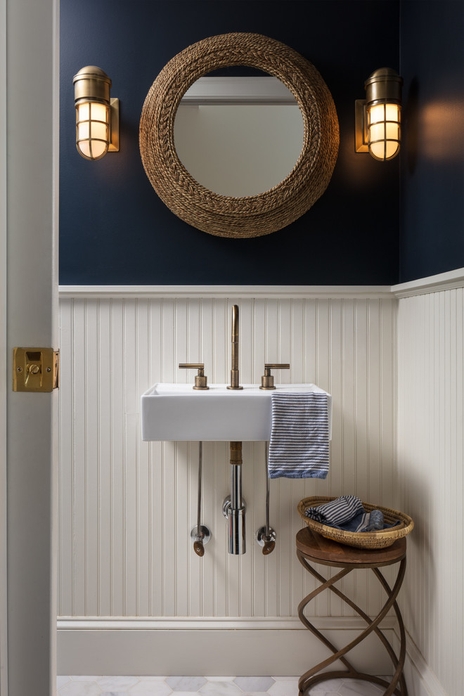 Inspiration for a small coastal marble floor and white floor powder room remodel in New York with blue walls and a wall-mount sink