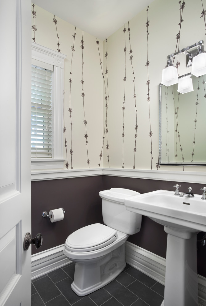 Example of a transitional powder room design in Chicago with a pedestal sink