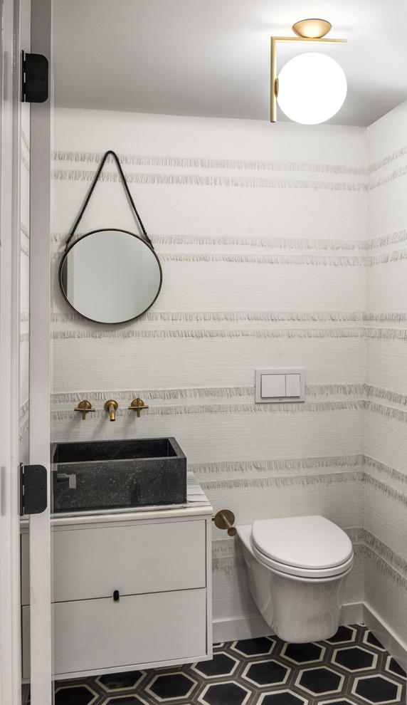 Trendy powder room photo in Chicago with a vessel sink, flat-panel cabinets, white cabinets, a wall-mount toilet and white walls