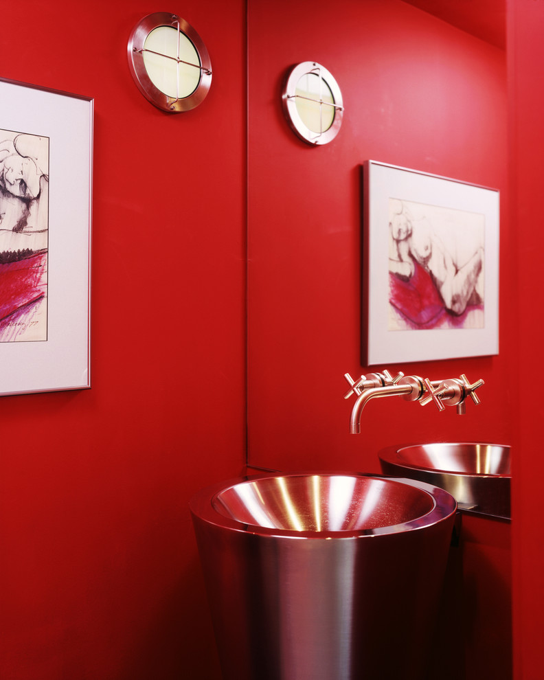 Trendy powder room photo in Austin with a pedestal sink and red walls