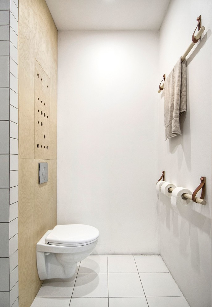 Inspiration for a small scandinavian powder room remodel in Saint Petersburg with a wall-mount toilet and white walls