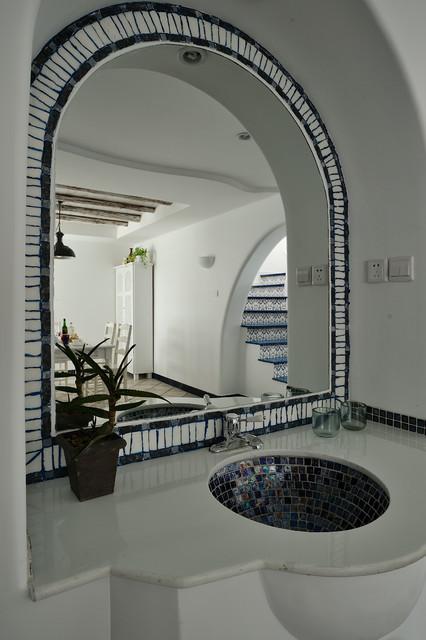 Inspiration for a mediterranean powder room remodel in Hong Kong