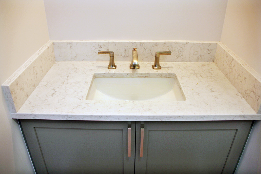 Example of a small minimalist powder room design in Portland with shaker cabinets, green cabinets, white walls, an undermount sink and quartz countertops
