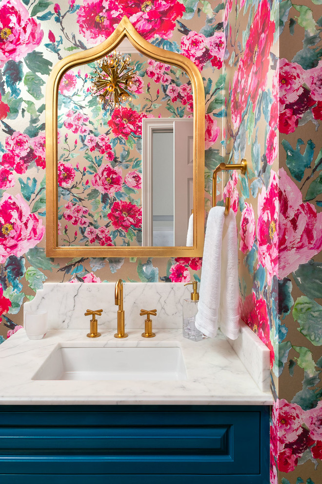 Transitional powder room photo in San Francisco with raised-panel cabinets, blue cabinets, multicolored walls, an undermount sink and white countertops