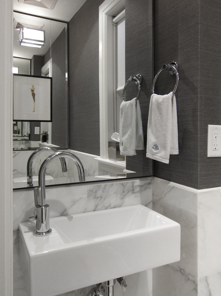 Powder room - small modern marble tile marble floor powder room idea in Toronto with gray walls and a wall-mount sink