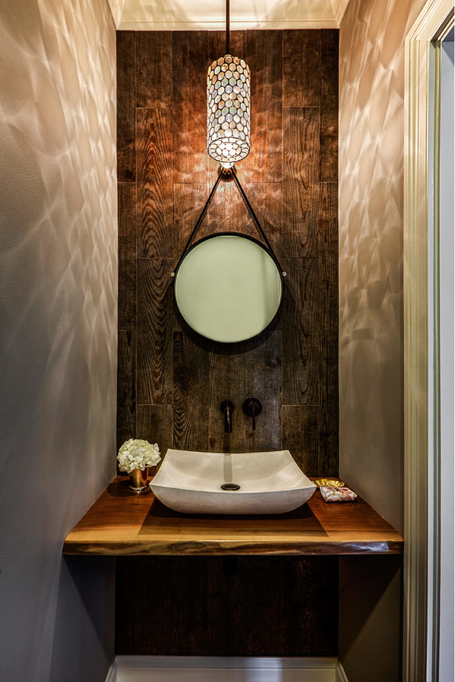 Powder room - transitional powder room idea in Chicago with a vessel sink