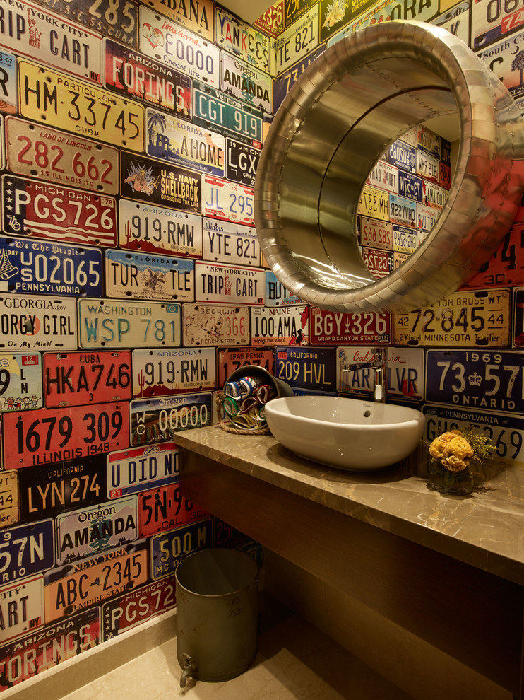 Eclectic powder room photo in Other with a vessel sink, flat-panel cabinets, dark wood cabinets, multicolored walls and brown countertops