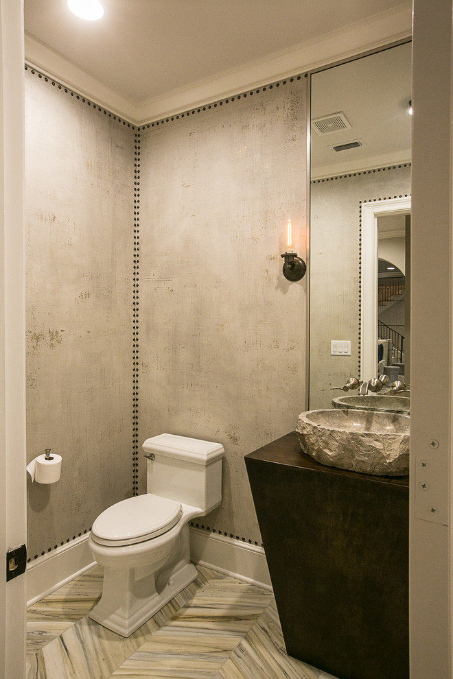 Powder room - transitional powder room idea in New Orleans with a vessel sink and gray walls
