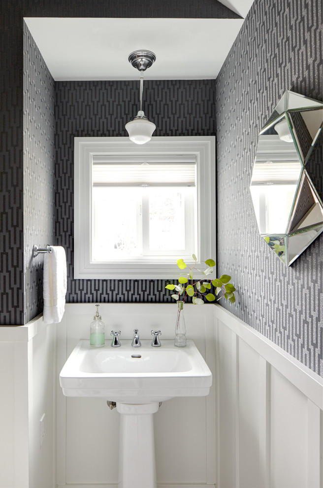 Example of a small classic powder room design in Seattle with a pedestal sink and multicolored walls