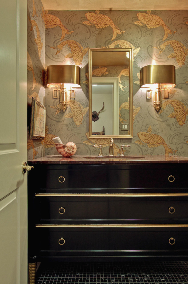 This is an example of a large traditional powder room in Philadelphia with furniture-like cabinets, black cabinets, multi-coloured walls, black tile, mosaic tile floors, an undermount sink and marble benchtops.