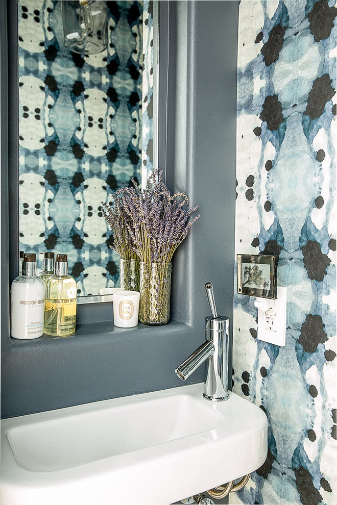 Inspiration for a contemporary powder room remodel in San Francisco with a wall-mount sink and multicolored walls