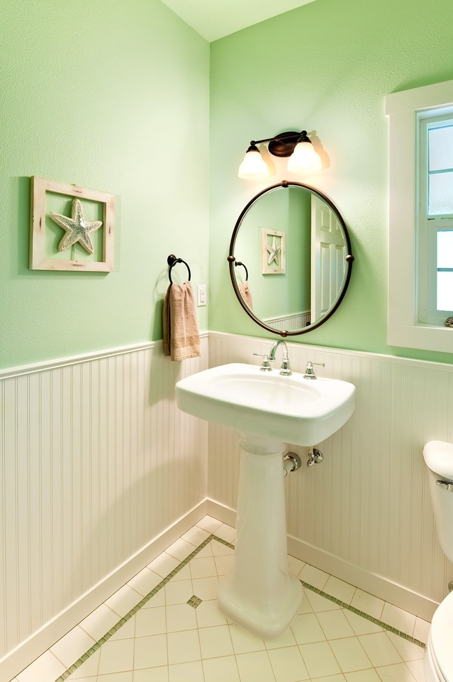 Powder room - small traditional white tile porcelain tile powder room idea in Portland with a pedestal sink and green walls