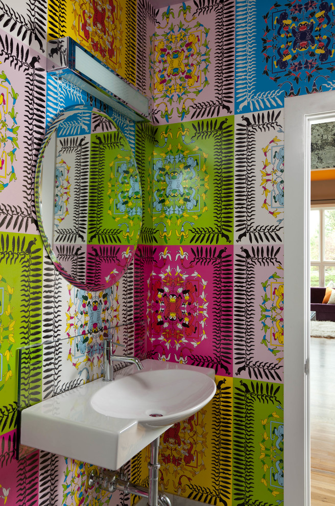 Inspiration for a small contemporary powder room remodel in Denver with a wall-mount sink and multicolored walls