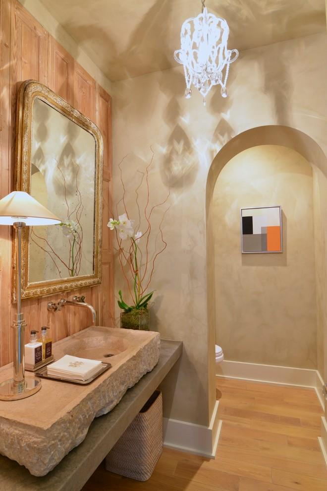 Tuscan light wood floor and beige floor powder room photo in Houston with beige walls