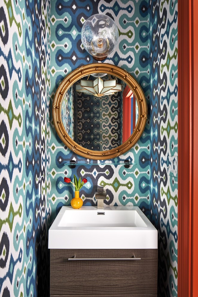 Small eclectic powder room photo in Boston with flat-panel cabinets, dark wood cabinets, multicolored walls and a console sink