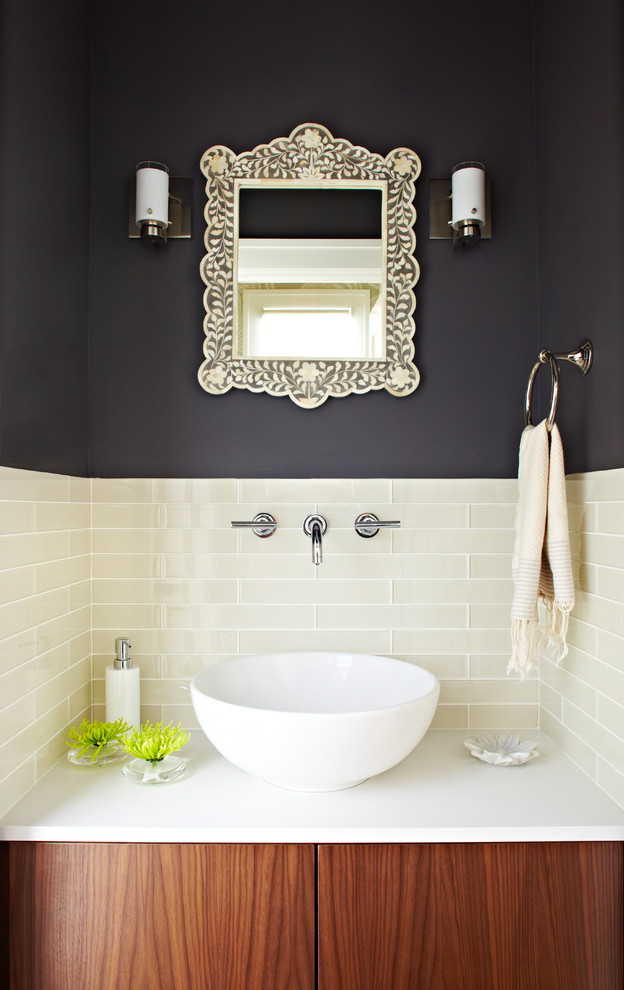 Powder room - transitional beige tile and glass tile powder room idea in San Francisco with a vessel sink, solid surface countertops and white countertops