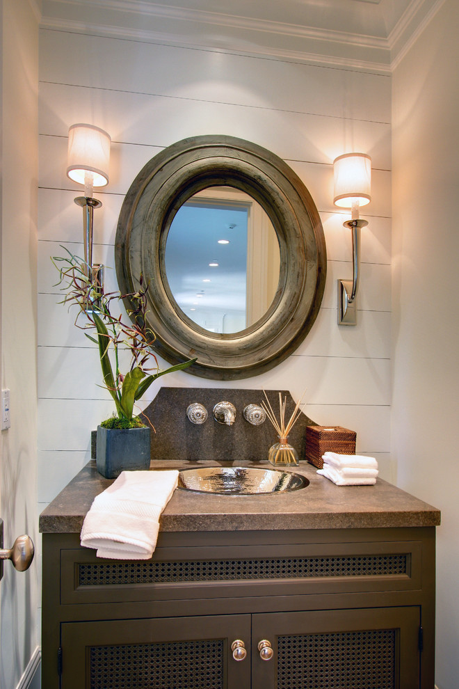 Powder room - traditional powder room idea in Los Angeles with a drop-in sink, recessed-panel cabinets, dark wood cabinets and brown countertops