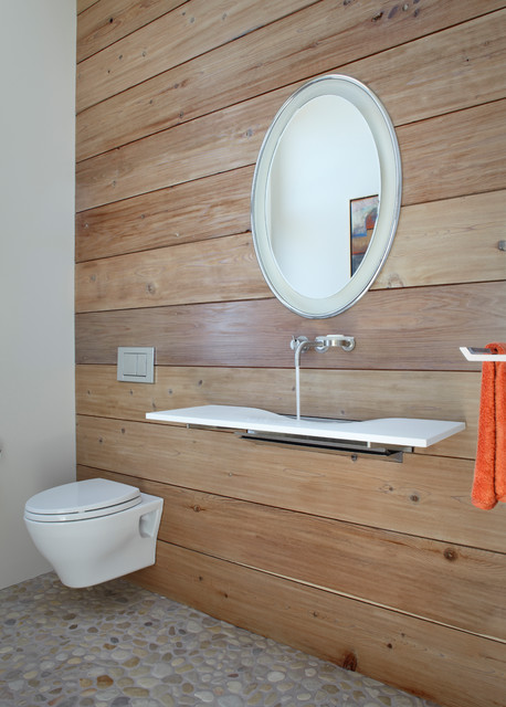 Inspiration for a contemporary pebble tile floor powder room remodel in Other with a wall-mount sink and a wall-mount toilet