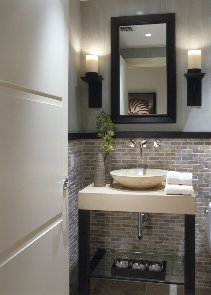 Example of a transitional powder room design in Miami with a vessel sink
