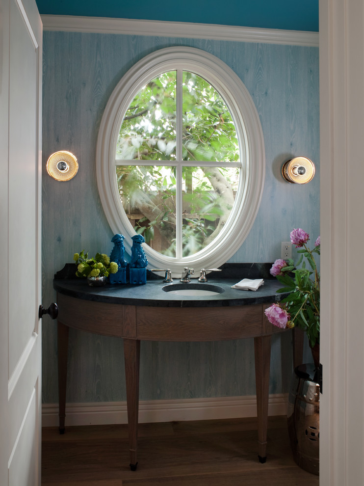 Example of a classic powder room design in San Francisco with soapstone countertops and an undermount sink