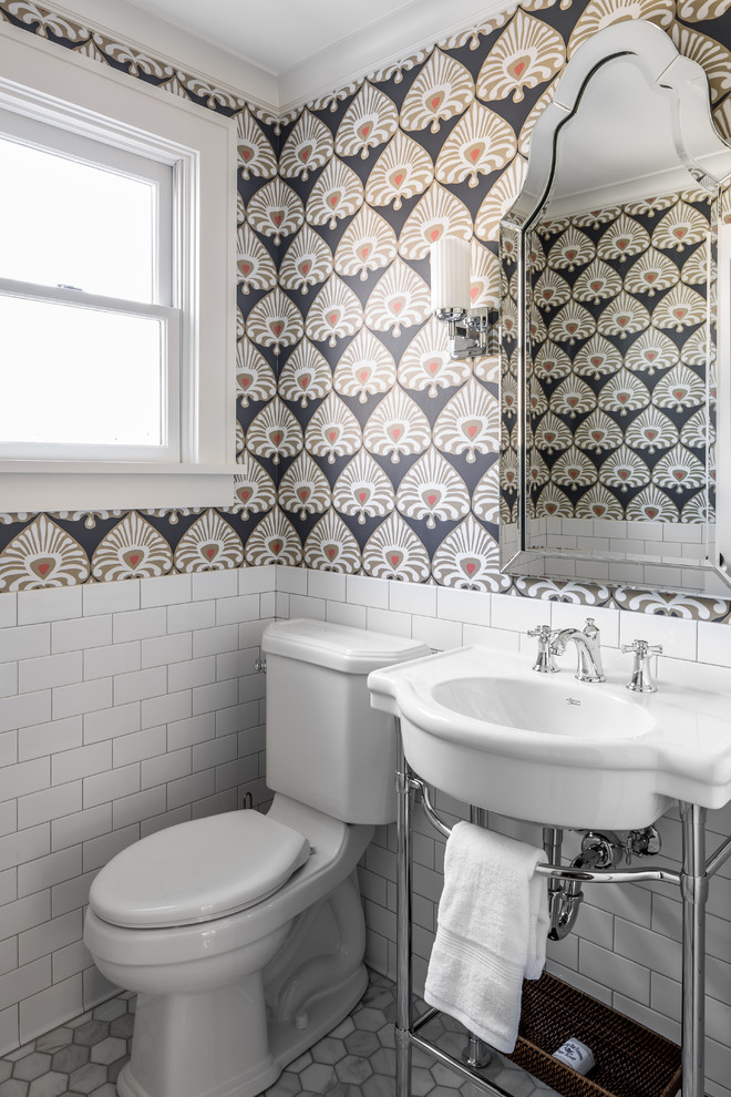 Inspiration for a timeless marble floor powder room remodel in Minneapolis with a two-piece toilet, multicolored walls and a console sink