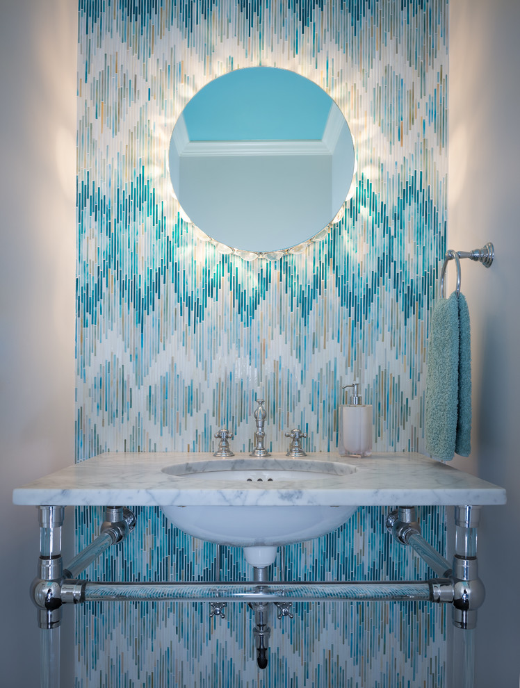 Example of a trendy blue tile and matchstick tile powder room design in Nashville with an undermount sink