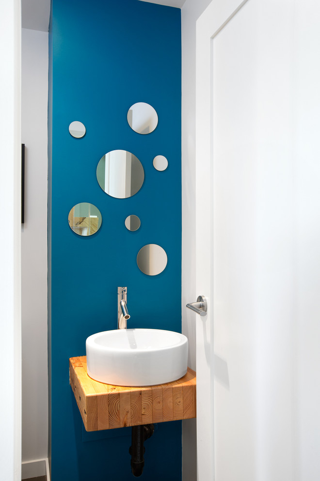 Inspiration for a contemporary powder room remodel in Vancouver with a vessel sink