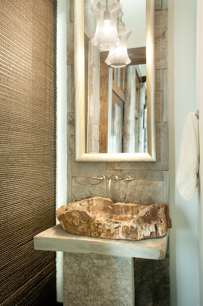 Example of a small mountain style powder room design in Charlotte with a vessel sink and gray countertops