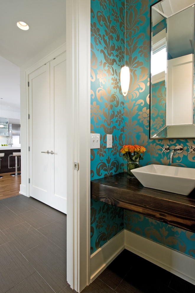 Trendy powder room photo in Minneapolis with a vessel sink and brown countertops