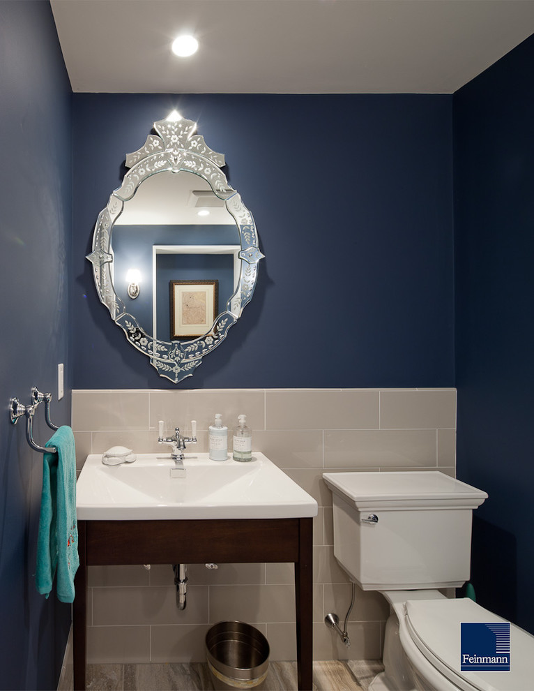 Inspiration for a timeless powder room remodel in Boston with a console sink