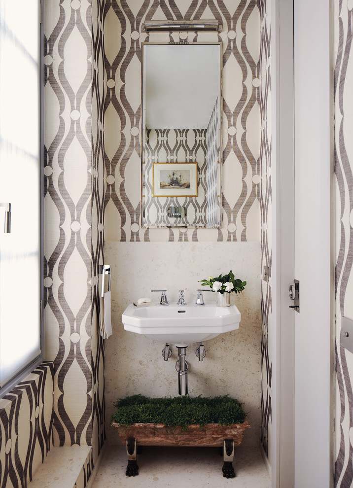 Powder room - small transitional powder room idea in New York with a wall-mount sink