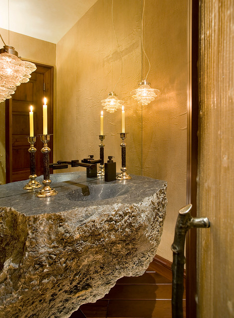 Example of a mountain style powder room design in Denver with an integrated sink