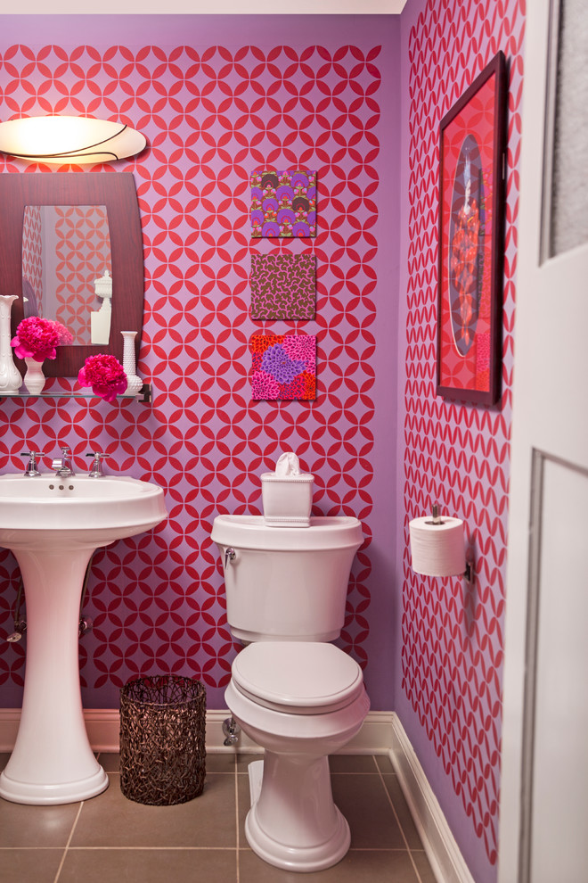 Powder room - small eclectic ceramic tile powder room idea in Philadelphia with a pedestal sink, a two-piece toilet and multicolored walls