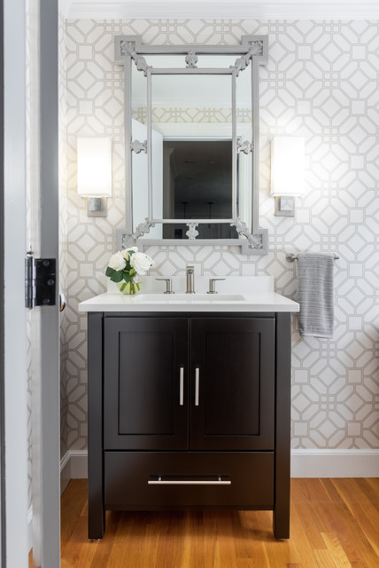 Powder room - mid-sized transitional medium tone wood floor and brown floor powder room idea in Boston with black cabinets, gray walls, an undermount sink, white countertops, furniture-like cabinets and engineered quartz countertops