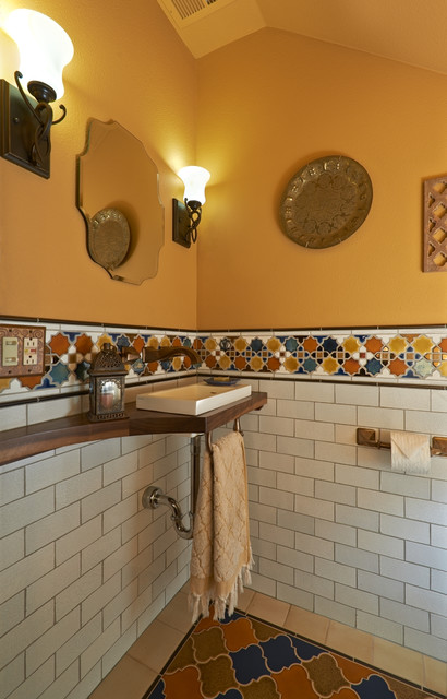 Old english library mediterranean powder room for Kitchen library portland