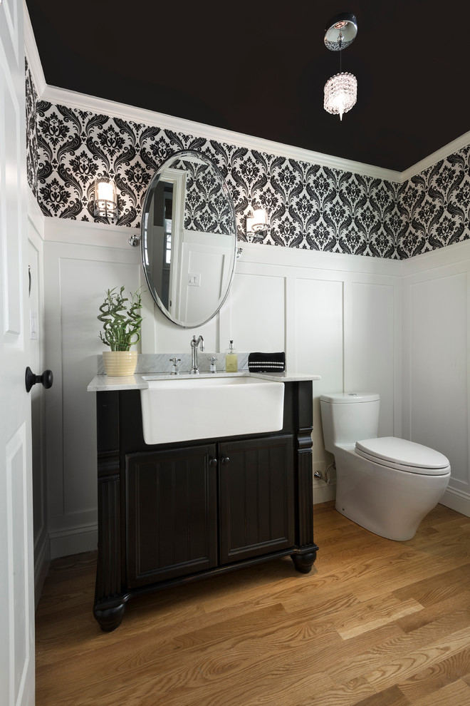 Mid-sized elegant medium tone wood floor powder room photo in Boston with furniture-like cabinets, black cabinets, quartzite countertops and multicolored walls