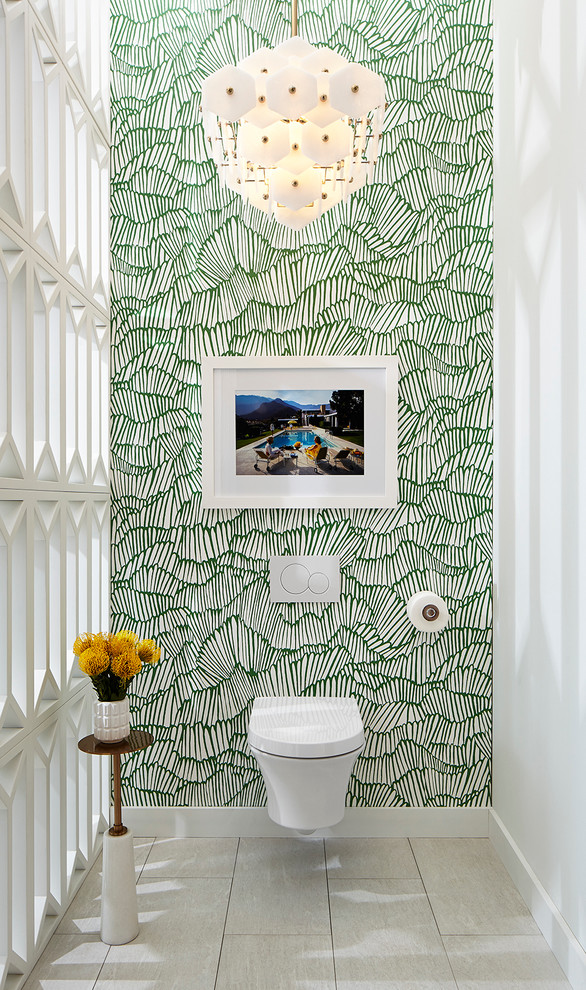 1960s porcelain tile and beige floor powder room photo in Dallas with a wall-mount toilet and multicolored walls