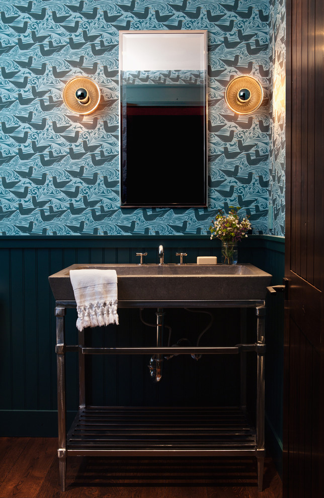 Example of a transitional powder room design in San Francisco with a console sink and multicolored walls