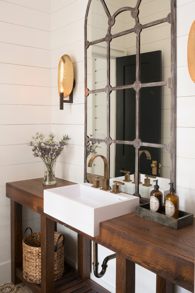 Transitional powder room photo in Other with a drop-in sink, open cabinets, wood countertops, white walls and brown countertops