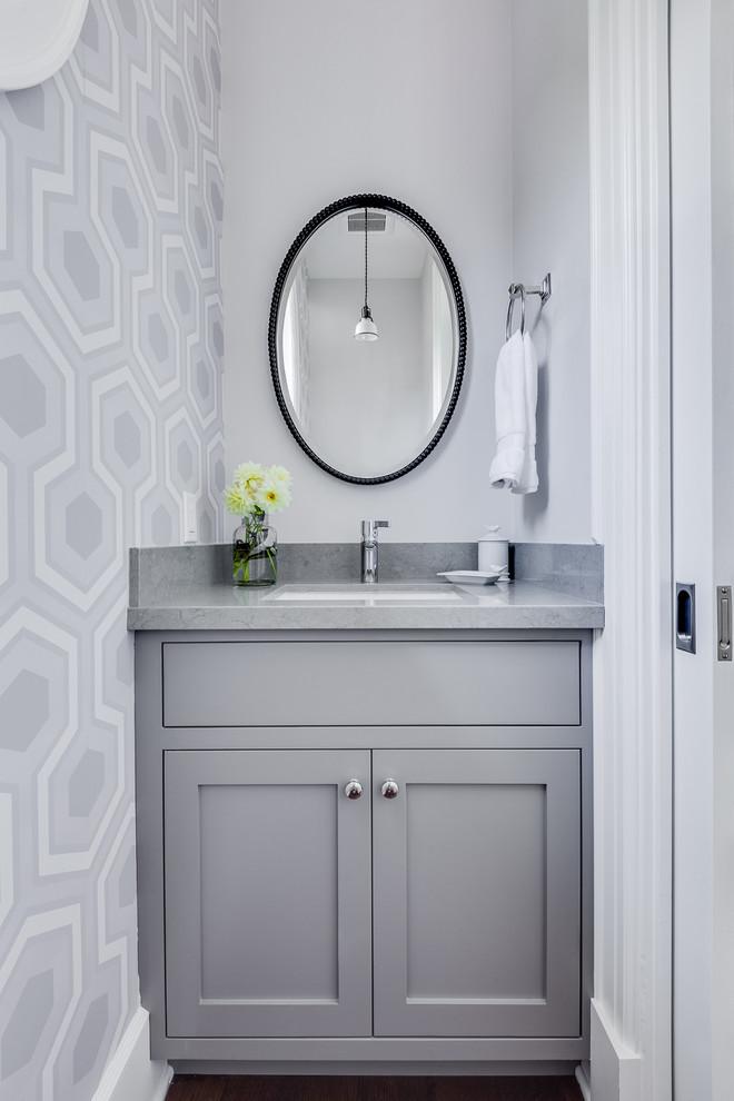 Transitional medium tone wood floor powder room photo in San Francisco with shaker cabinets, gray cabinets, quartz countertops, gray walls and gray countertops