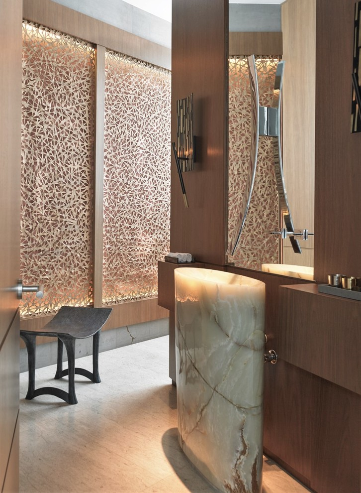 Inspiration for a contemporary beige floor powder room remodel in Other with dark wood cabinets and a pedestal sink