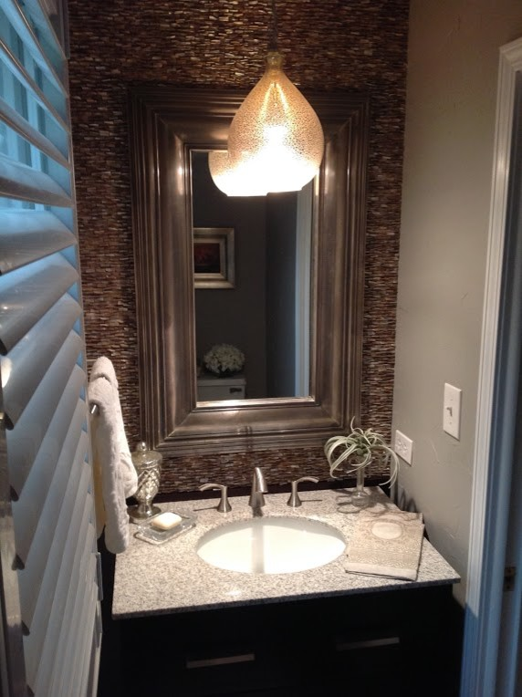 Small transitional brown tile and stone tile powder room photo in Chicago with gray walls, an undermount sink and terrazzo countertops
