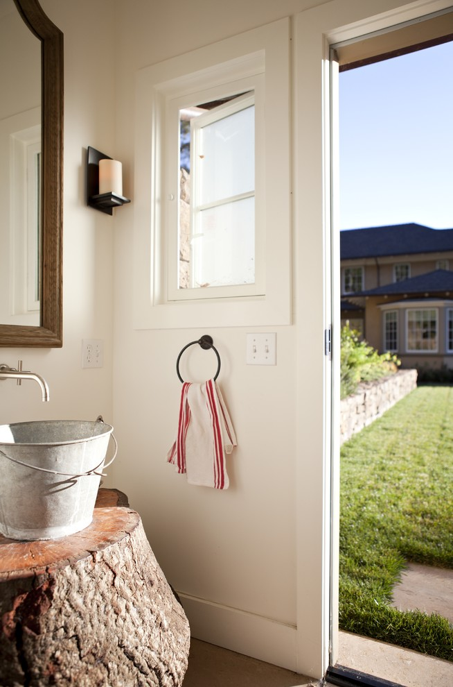 Inspiration for a farmhouse powder room remodel in San Francisco with a vessel sink