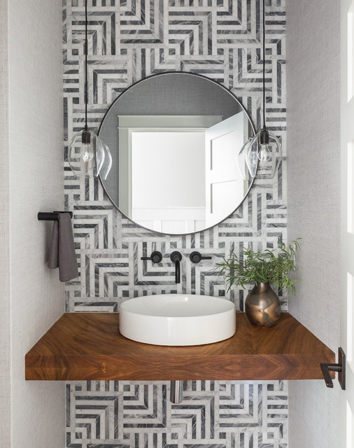 Powder room - transitional gray tile powder room idea in Seattle with gray walls, a vessel sink and brown countertops