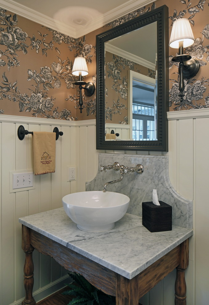 Inspiration for a timeless powder room remodel in Omaha with marble countertops, a vessel sink and gray countertops