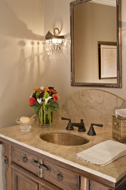 Small mountain style powder room photo in Los Angeles with an undermount sink, recessed-panel cabinets, medium tone wood cabinets, beige walls and beige countertops