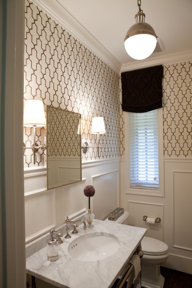 Example of a classic powder room design in Baltimore with marble countertops and white countertops